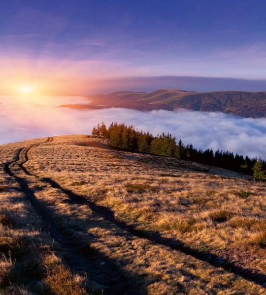Vliestapete Morgendämmerung Berge 225x250